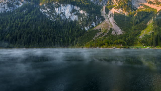 time lapse of moving fog and mist in morning, beautiful scenery landscape of gosausee mountain lake in fall. salzkammergut region upper austria - upper austria stock videos & royalty-free footage