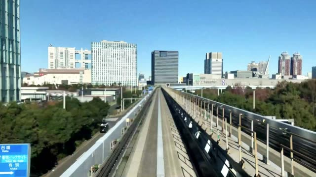 time lapse of moving train at day time, tokyo, japan - fast motion stock videos & royalty-free footage