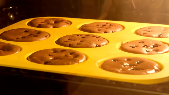 time lapse of muffins rising in the oven - muffin stock videos and b-roll footage