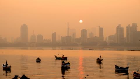 time lapse of mumbai skyline in sunrise - india stock videos & royalty-free footage