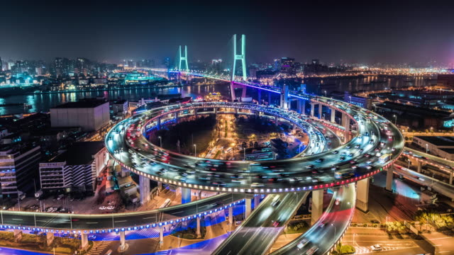 time lapse of nanpu bridge at night with neon lights - schanghai stock-videos und b-roll-filmmaterial