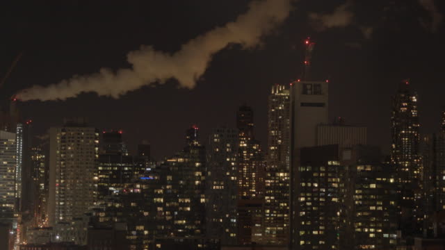 time lapse of new york city skyline metropolis panorama at night. urban landmark scenery background
