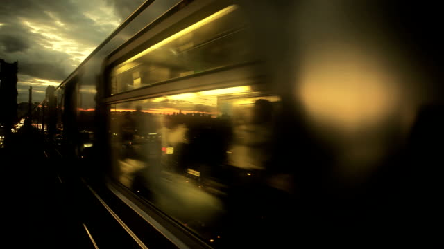 time lapse of new york subway train traveling at sunset - underground rail stock videos & royalty-free footage