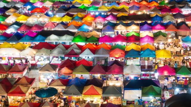 time lapse of night market in bangkok, thailand - night market stock videos & royalty-free footage
