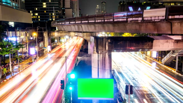 Time Lapse of Night Traffic car in Bangkok city with green screen. Zoom out shot