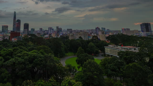 Time lapse of nightfall over looking reunification palace, Saigon, district 1, HCMC