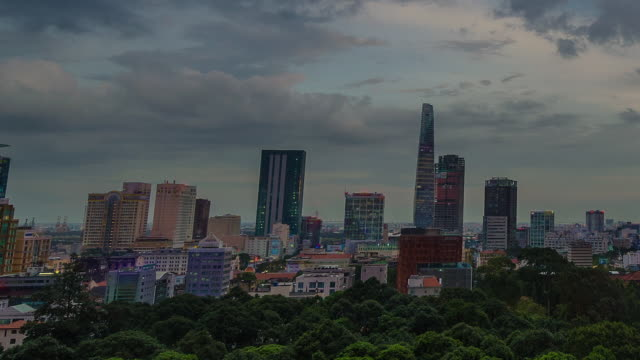Time lapse of nightfall over looking Saigon district 1, HCMC