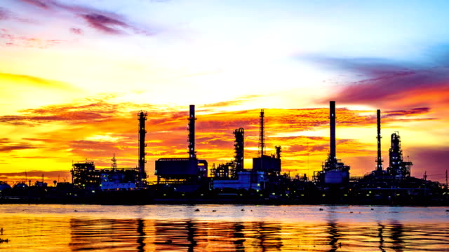Time lapse of oil refinery plant at twilight morning