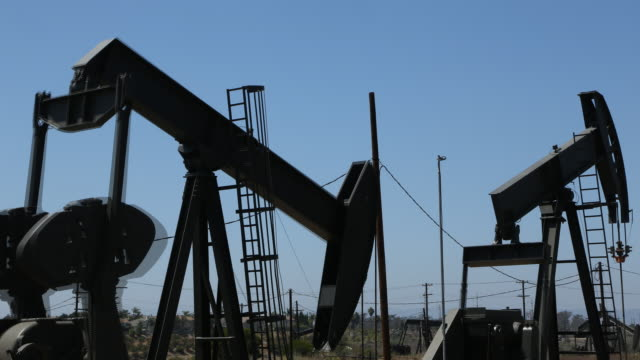 time lapse of oil wells pumping fast - power equipment stock videos & royalty-free footage