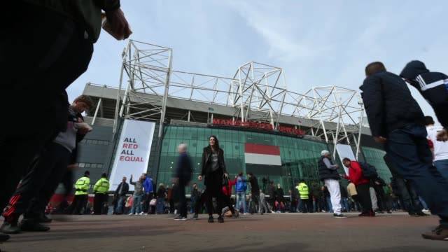 time lapse of old trafford stadium, home of manchester united football club, showing fans arriving for a match. - long exposure stock videos & royalty-free footage