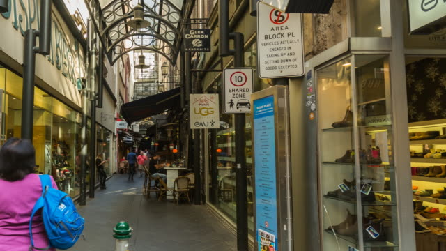 4k time lapse of one of iconic melbourne arcades/lanes with cafes and people, victoria, australia - road sign stock videos & royalty-free footage