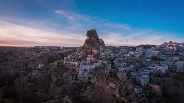 time lapse of ortahisar cave city in cappadocia, turkey on sunset - cappadocia stock videos and b-roll footage
