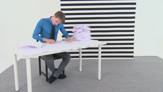 Time lapse of overworked office worker with sign saying help
