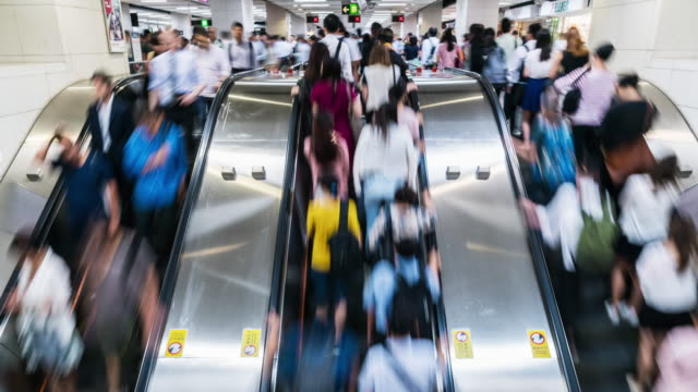 4K Time lapse of passenger and tourist walking and running on escalator in rush hour, Central Station, Hong Kong
