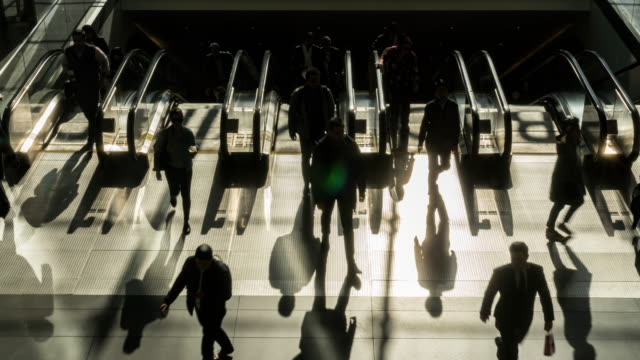 time lapse of passenger and tourist walking and running on escalator - rush hour stock videos & royalty-free footage