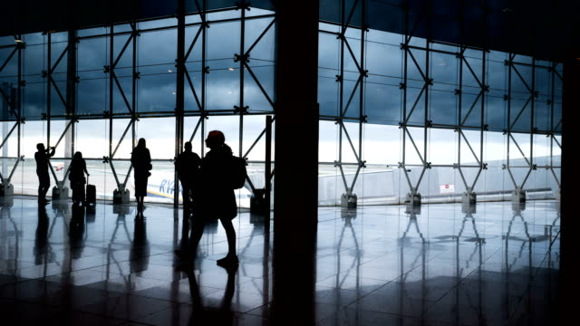 time lapse of passenger at barcelona el prat airport (silhouetted scene) - passenger stock videos & royalty-free footage
