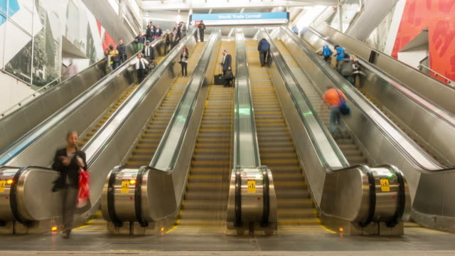time lapse of passengers at the subway station - escalator stock videos & royalty-free footage