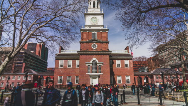 time lapse of pedestrian and tourist walking around independence hall in philadelphia - independence hall stock videos & royalty-free footage