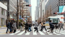 4K Time lapse of pedestrians and car crowd undefined people walking overpass the street intersection cross-walk in Tokyo city, Japan. Japanese culture and travel concept