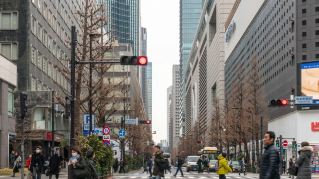 4k time lapse of pedestrians and car crowd undefined people walking overpass the street intersection cross-walk in tokyo city, japan. japanese culture and travel concept - zebra crossing stock videos & royalty-free footage