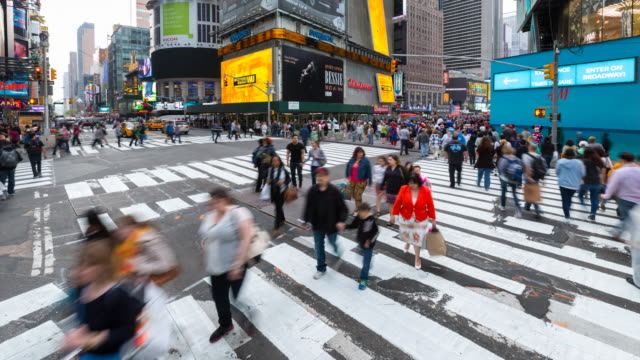 Time Lapse of pedestrians and cars at Times Square intersection