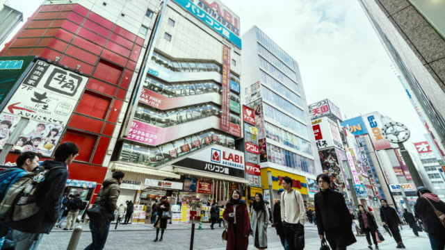4k time lapse of pedestrians crowd undefined people walking overpass the street intersection cross-walk in akihabara tokyo city, japan. japanese culture and electric town shopping area concept - akihabara station stock videos and b-roll footage