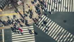 4K Time lapse of pedestrians crowd undefined people walking overpass the street intersection cross-walk in Ginza Tokyo city, Japan