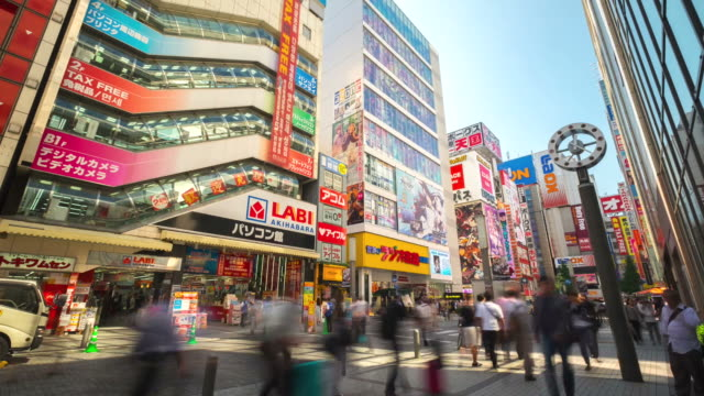 time lapse of pedestrians crowded shopping akihabara electric town tokyo - akihabara stock videos and b-roll footage