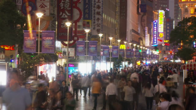 time lapse of people along nanjing road in shanghai china - nanjing road stock videos & royalty-free footage