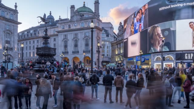time lapse of people and traffic in piccadilly circus, london, england, united kingdom, europe - london england stock videos & royalty-free footage