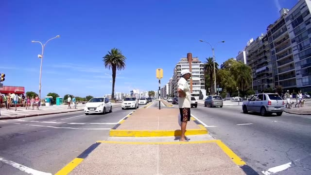 Time lapse of people and traffic, summer time, Montevideo, Uruguay, 2015