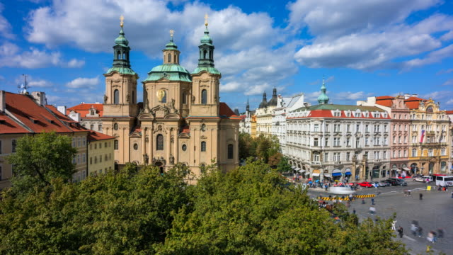 time lapse of people and traffics in front of st. nicholas' church in prague, czech republic - st nicholas's church prague stock videos and b-roll footage