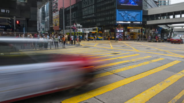 time lapse of people crossing a busy road in central, hong kong - hong kong island stock videos & royalty-free footage