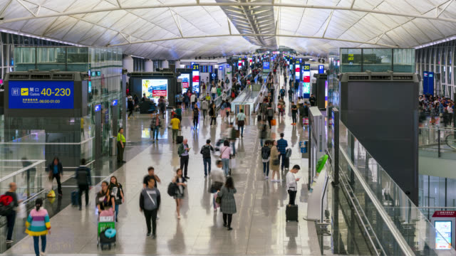 time lapse of people crowd at airport departure area at hong kong in china - airline check in attendant stock videos and b-roll footage