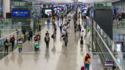 Time lapse of people crowd at airport departure area at Hong Kong in China
