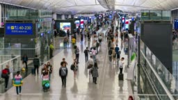 Time lapse of people crowd at airport departure area in Hong Kong China