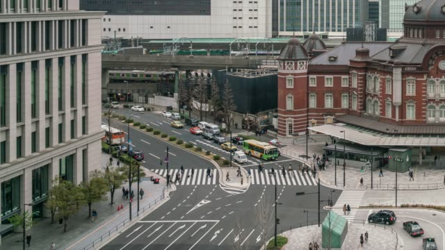 4k time lapse of people crowd visiting and enjoying at tokyo station and marunouchi with car traffic tokyo city, japan. japanese culture and transportation concept - marunouchi stock videos & royalty-free footage