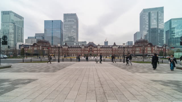 4k time lapse of people crowd visiting and enjoying with car traffic at tokyo station and marunouchi tokyo city, japan. japanese culture and transportation concept - marunouchi stock videos & royalty-free footage
