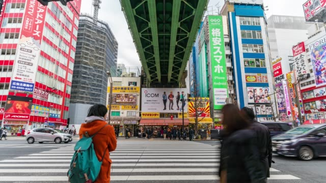 4k time lapse of people crowd walking overpass the street intersection cross-walk with car traffic in akihabara tokyo city, japan. japanese culture and electric town shopping area concept - akihabara stock videos and b-roll footage