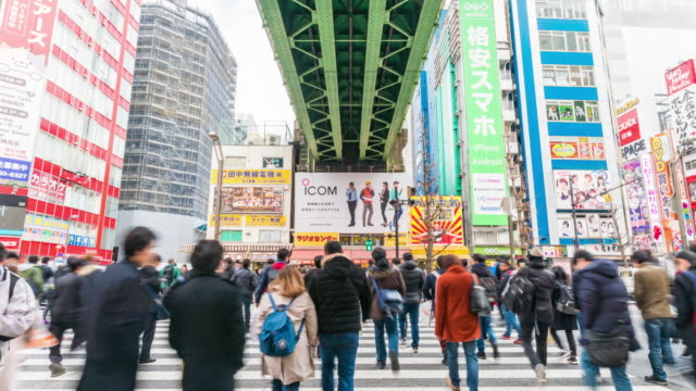 4k time lapse of people crowd walking overpass the street intersection cross-walk with car traffic in akihabara tokyo city, japan. japanese culture and electric town shopping area concept - akihabara station stock videos and b-roll footage