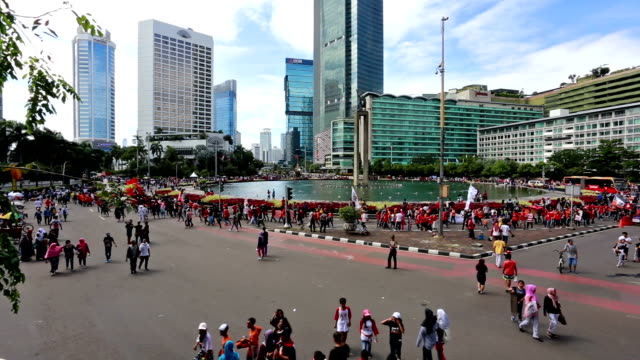 time lapse of people enjoying the car free day in jakarta - indonesia street stock videos & royalty-free footage
