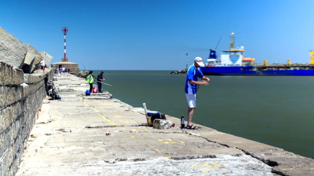 time lapse of people fishing by montevideo's harbor - rio de la plata stock videos & royalty-free footage