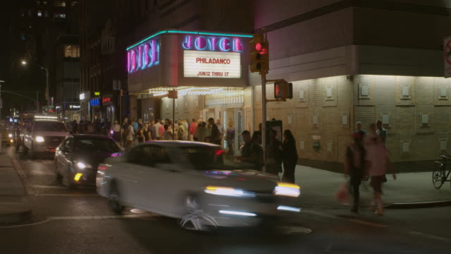 time lapse of people letting out of the the joyce theater in manhattan new york city at night. - theater industry stock videos and b-roll footage