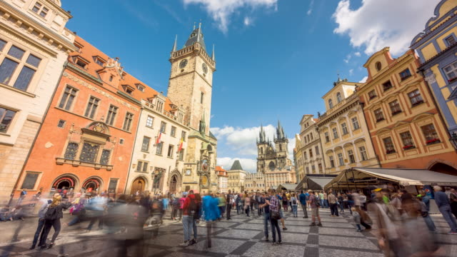 time lapse of people moving past the astronomical clock and through old times square, in the center of prague, czech republic - astronomical clock prague stock videos and b-roll footage