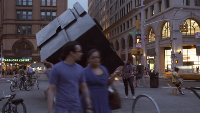 Time Lapse of people moving the cube in Cooper union early evening