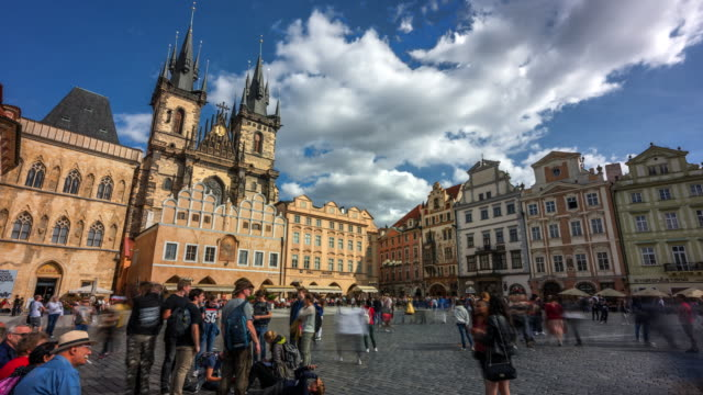 time lapse of people tourist and moving cloud in front of bell towers of  church of our lady before tyn in prague, czech republic - tyn church stock videos & royalty-free footage