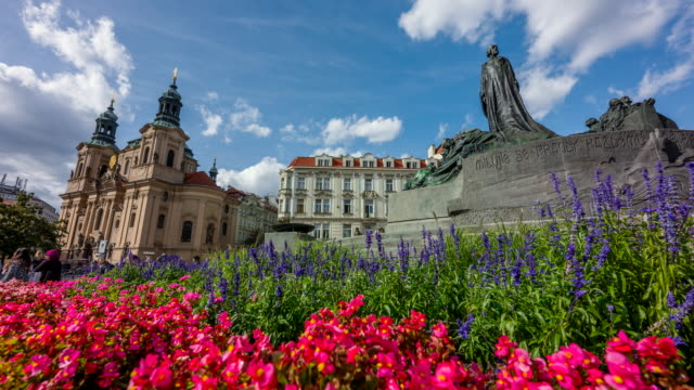 time lapse of people tourist walking and moving cloud at jan hus monument, center of old town, prague, czech republic - st nicholas's church prague stock videos and b-roll footage