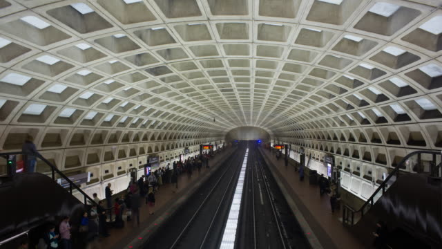 time lapse of people waiting on the platform for the underground train to arrive, pentagon subway station, washington dc, usa - the pentagon stock videos and b-roll footage