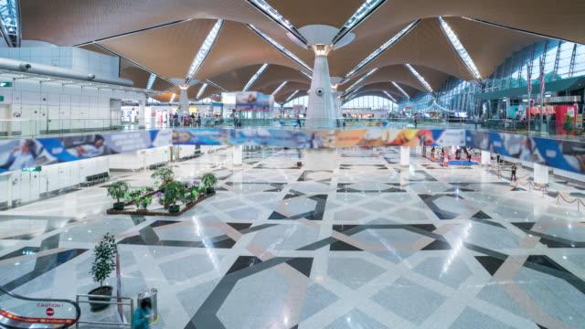 time lapse of people waling at kul international airport, malaysia - kuala lumpur stock videos & royalty-free footage