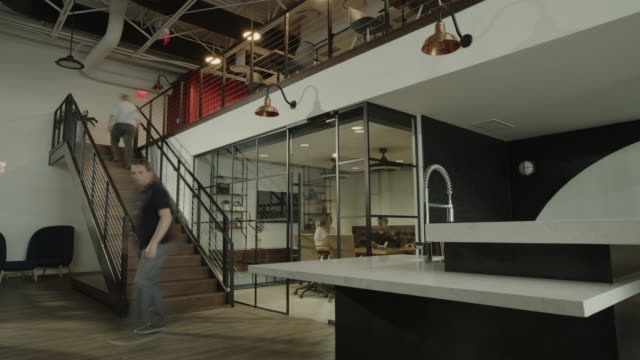 time lapse of people walking and working in busy modern office / centerville, utah, united states - casual clothing点の映像素材/bロール